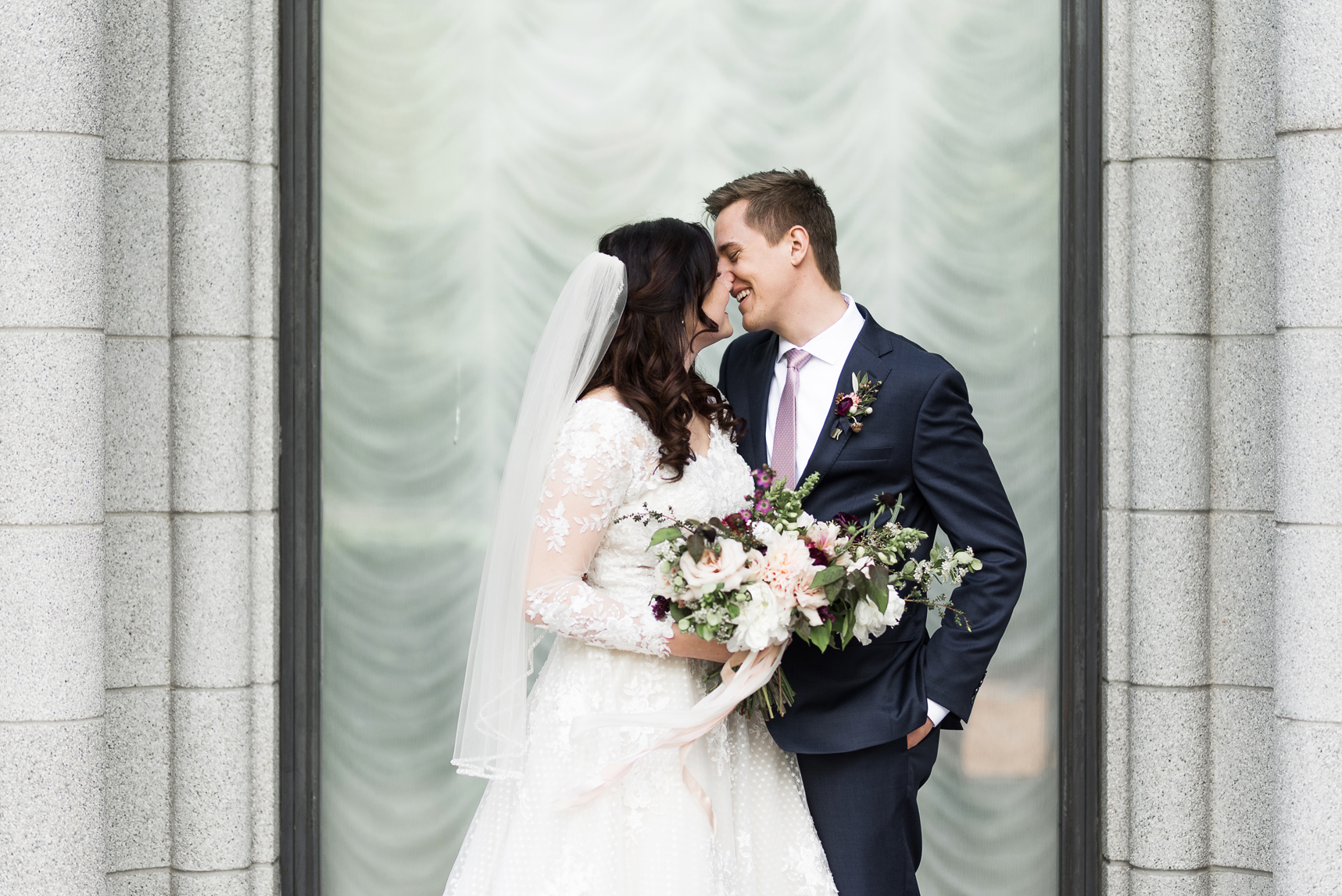 bride and groom kissing at the salt lake city lds temple