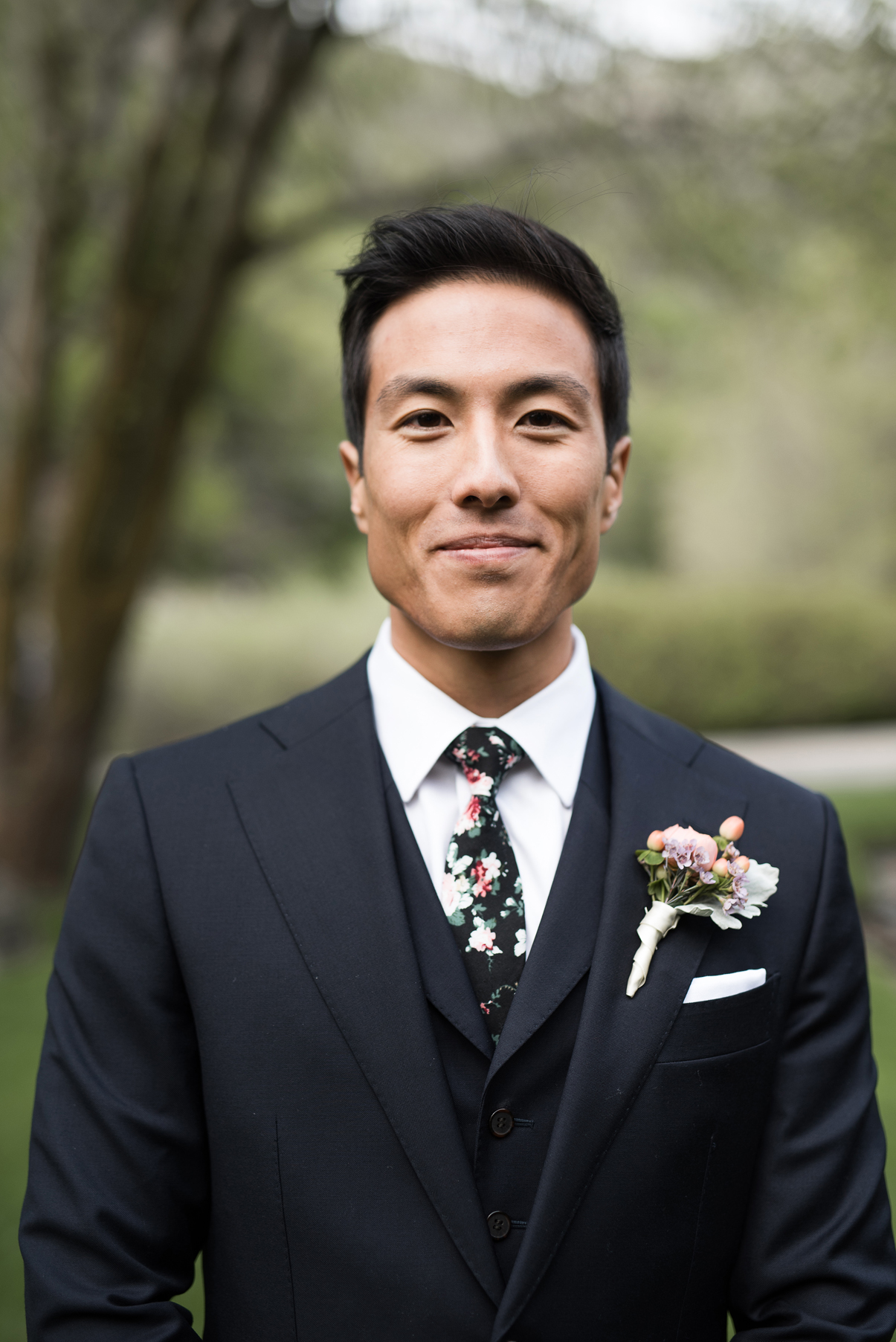 groom in floral tie and blue suit