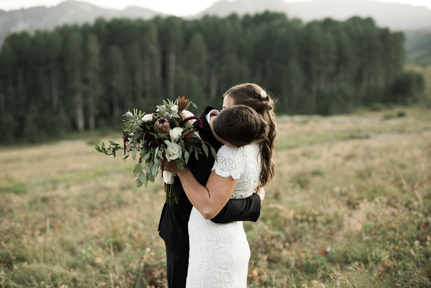 groom romantically kissing brides neck