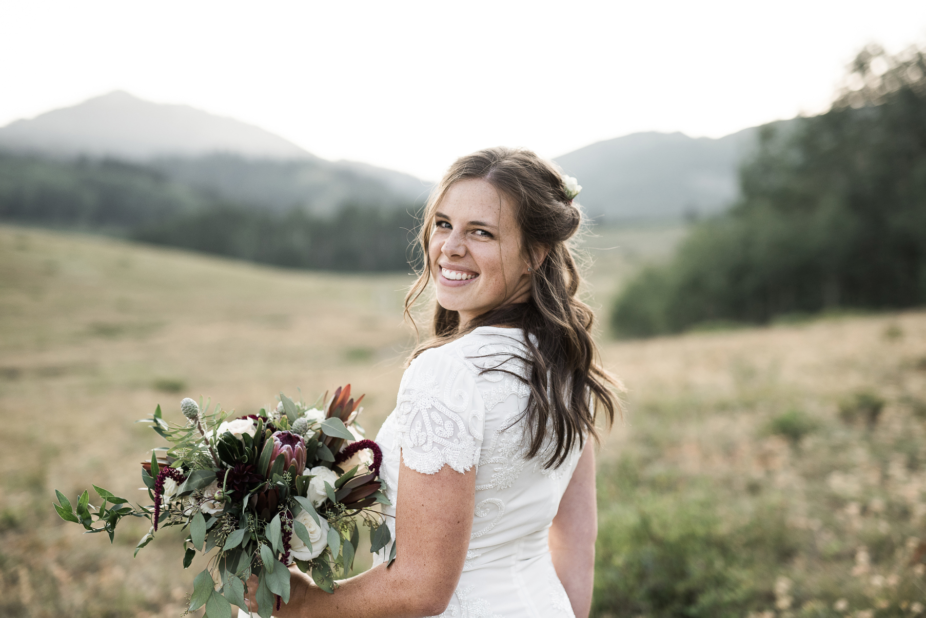 happy bride in utahs mountains