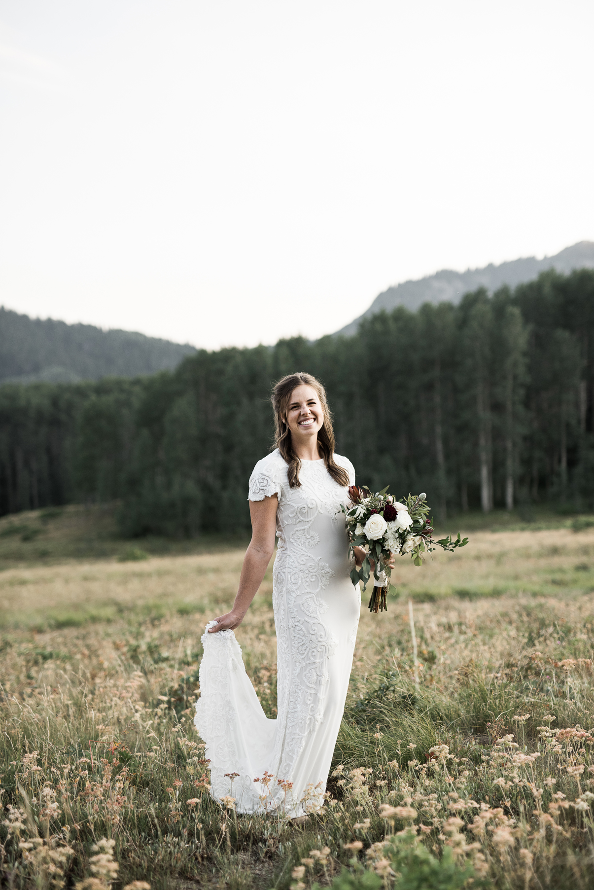 bride in form fitting beaded gown
