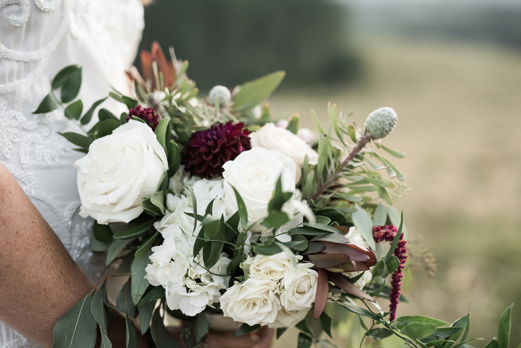 white flowers in classic wedding bouquet