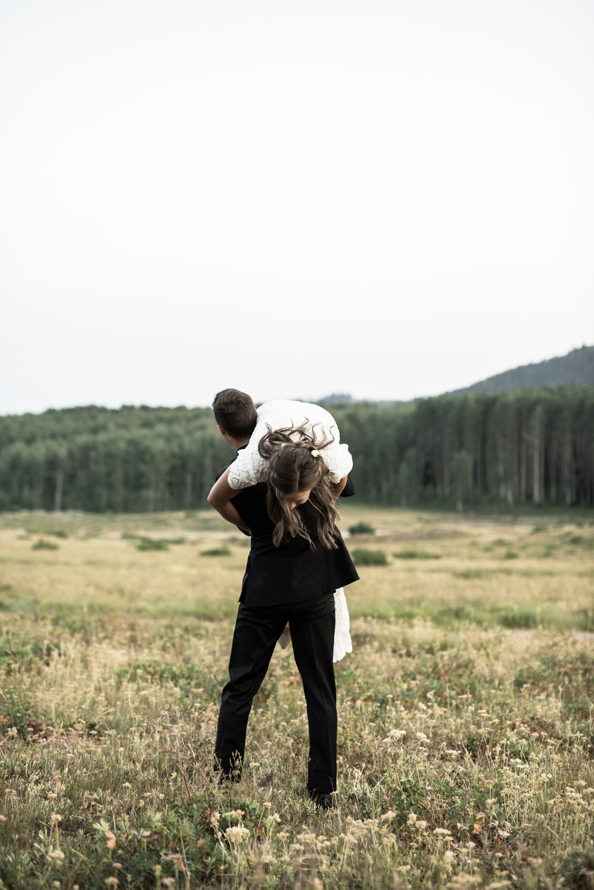 candid portraiture of bride and groom in the mountains