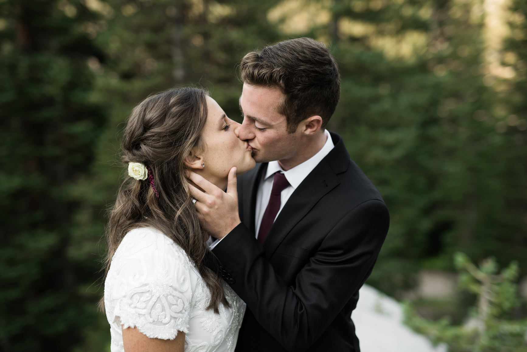 groom pulling in bride for a kiss