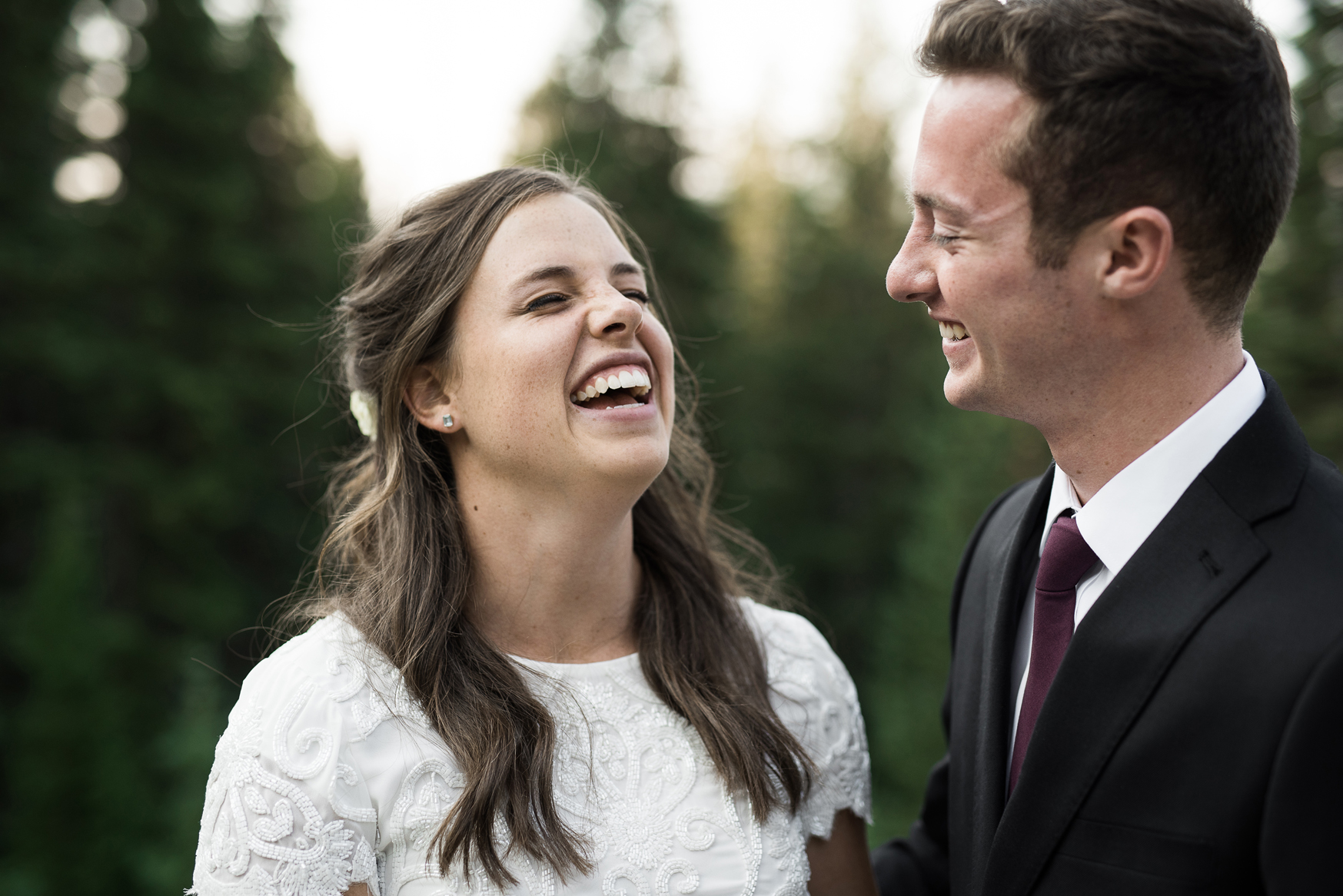bride and groom laughing with happiness