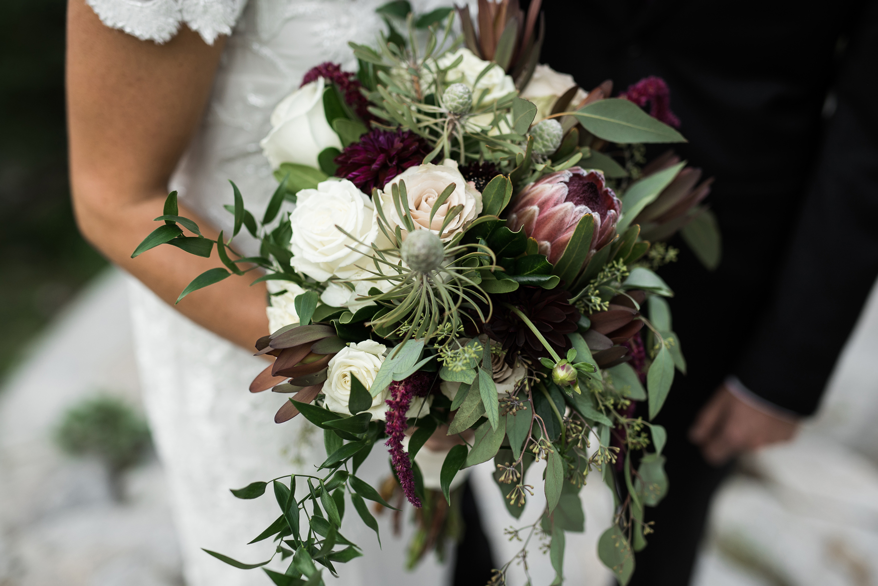 neutral bridal bouquet with greenery