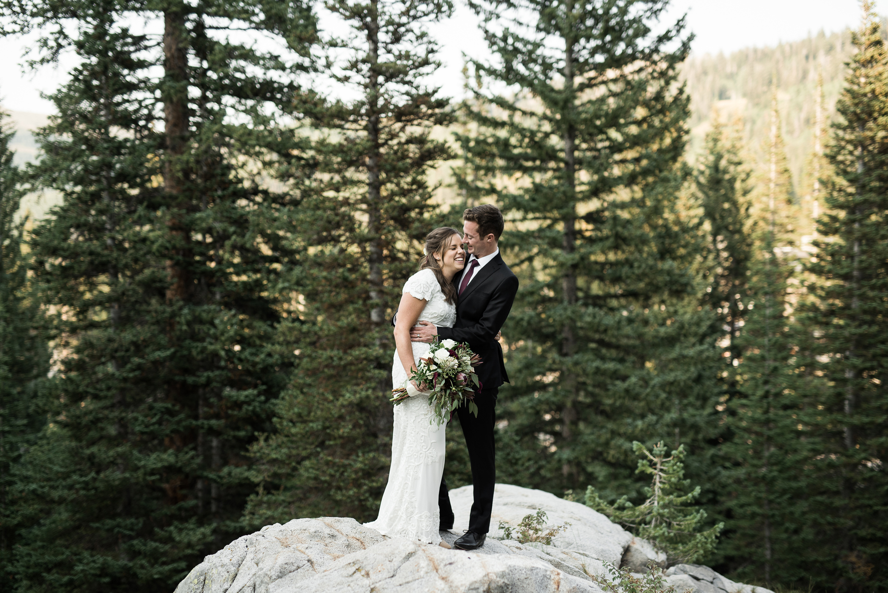 couple holding each other close in big cottonwood canyon