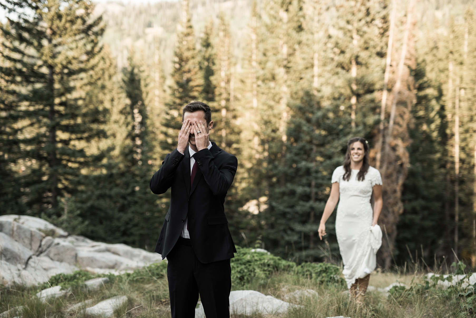 groom covering his eyes during first look