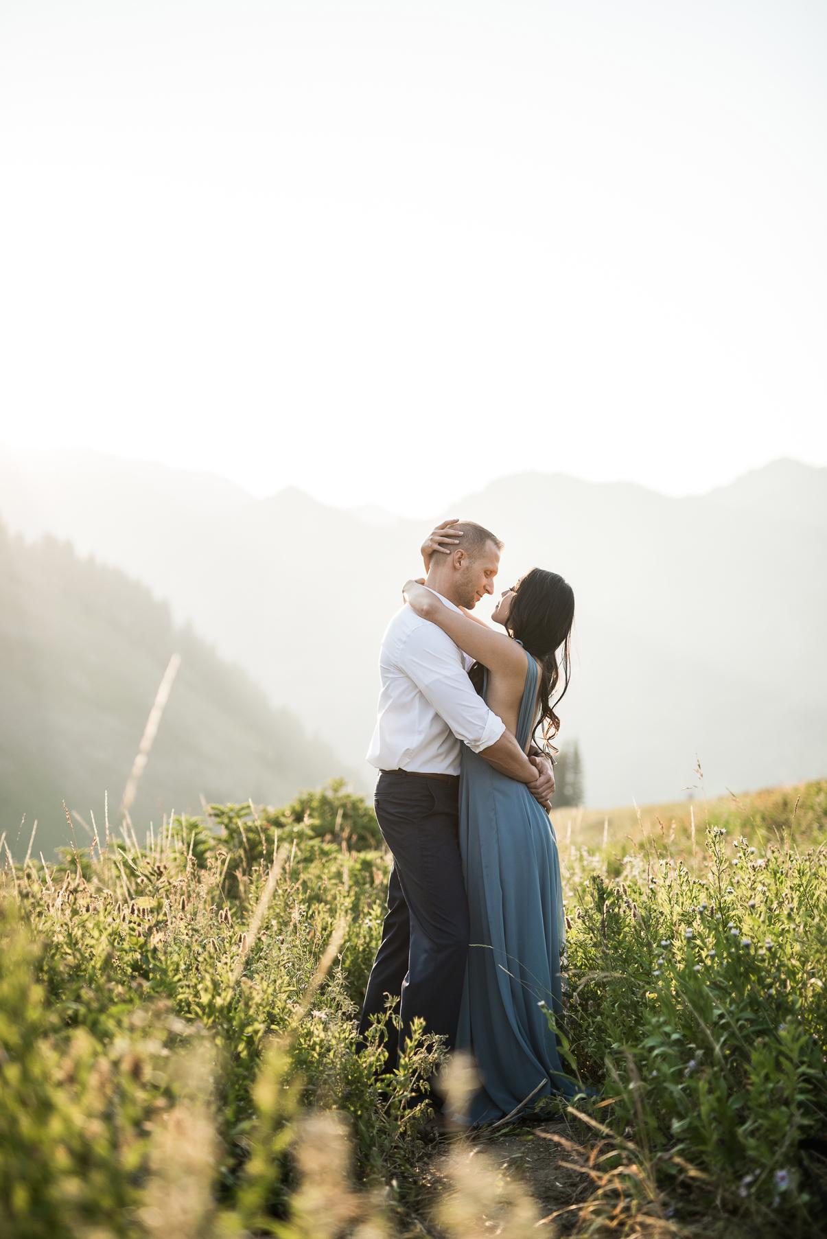 bride and groom hugging overlooking alta ski resort