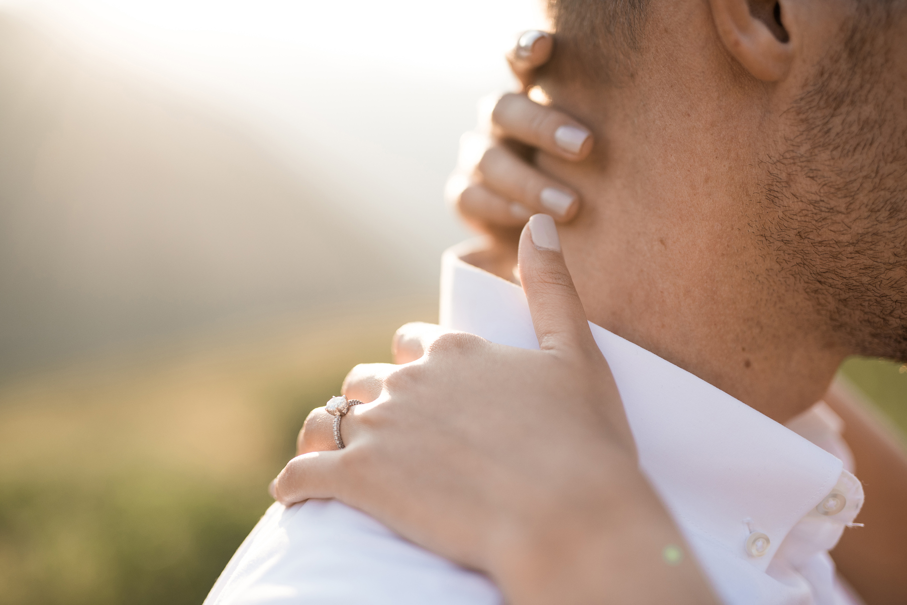 brides hands wrapped around her fiance