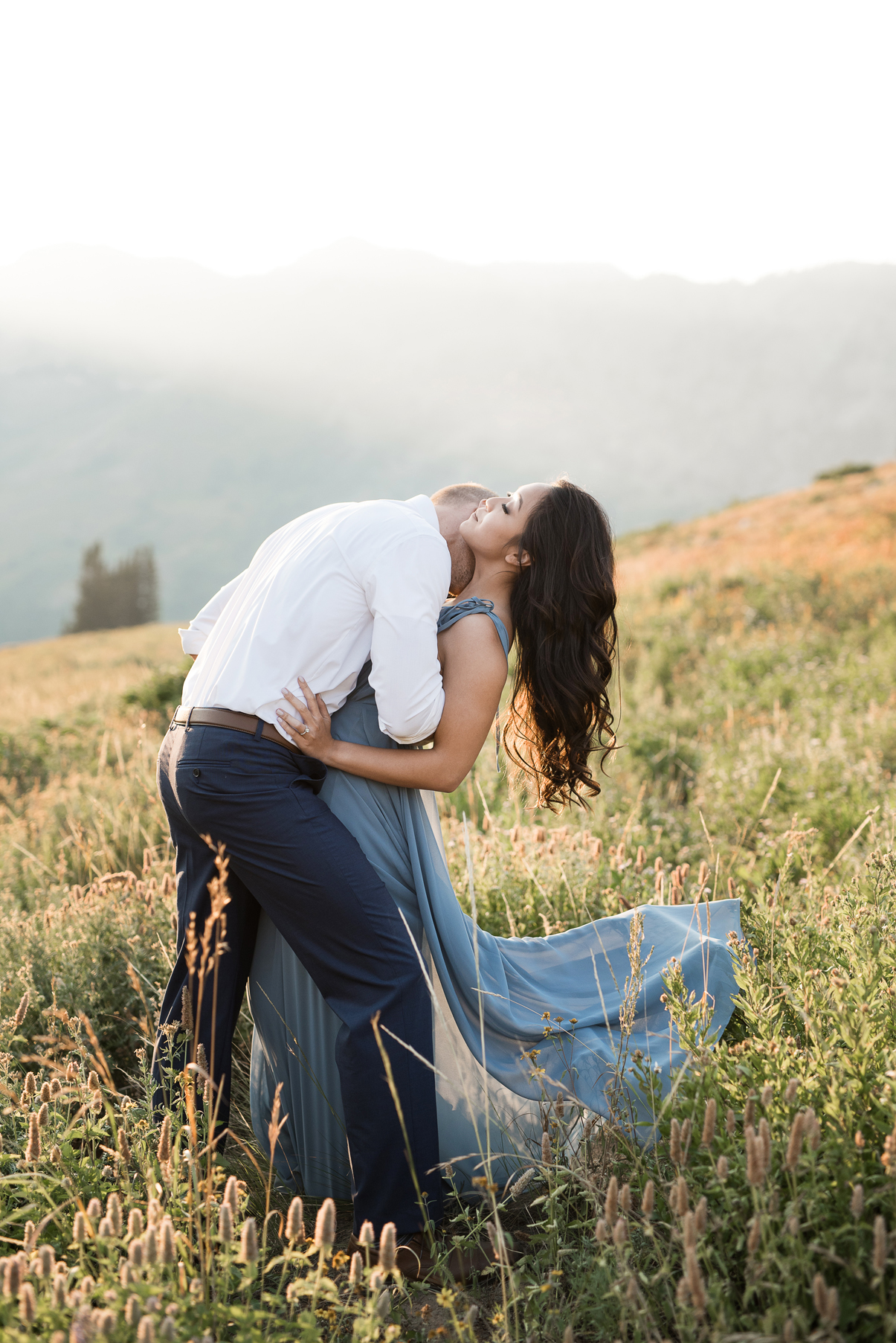 passionate neck kiss in the mountains