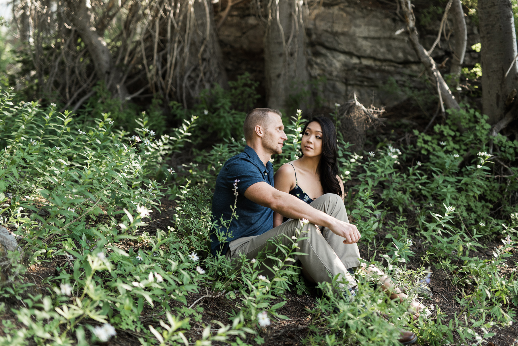 Couple relaxing in a flower filled mountainside