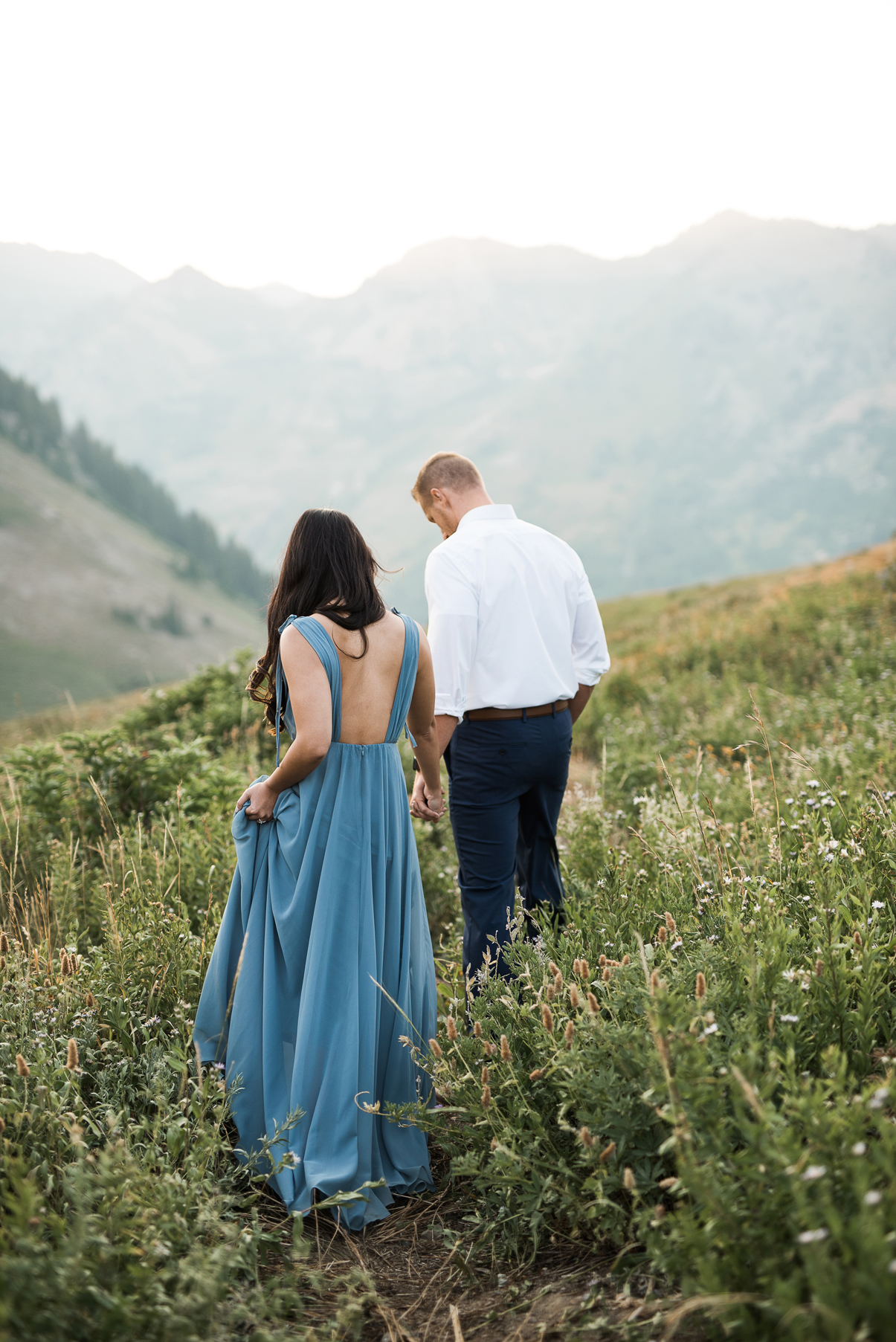 bride and groom walking through little cottonwood canyon