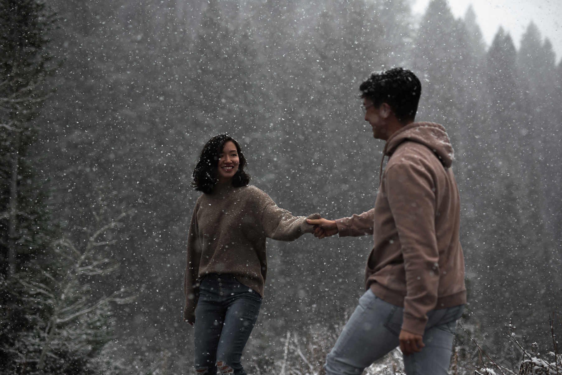 candid engagements in snowy big cottonwood canyon
