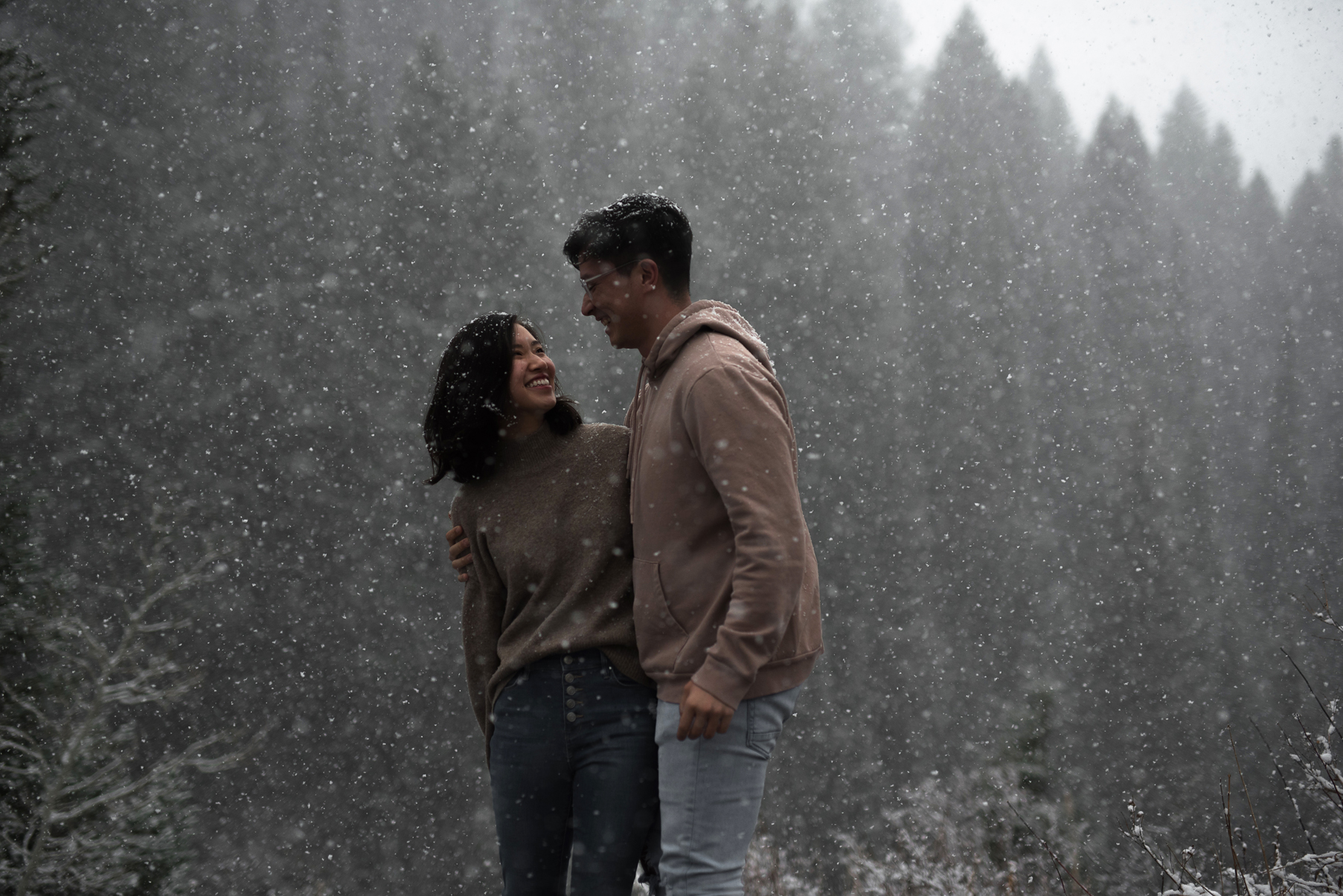 rad couple in the snow in big cottonwood canyon