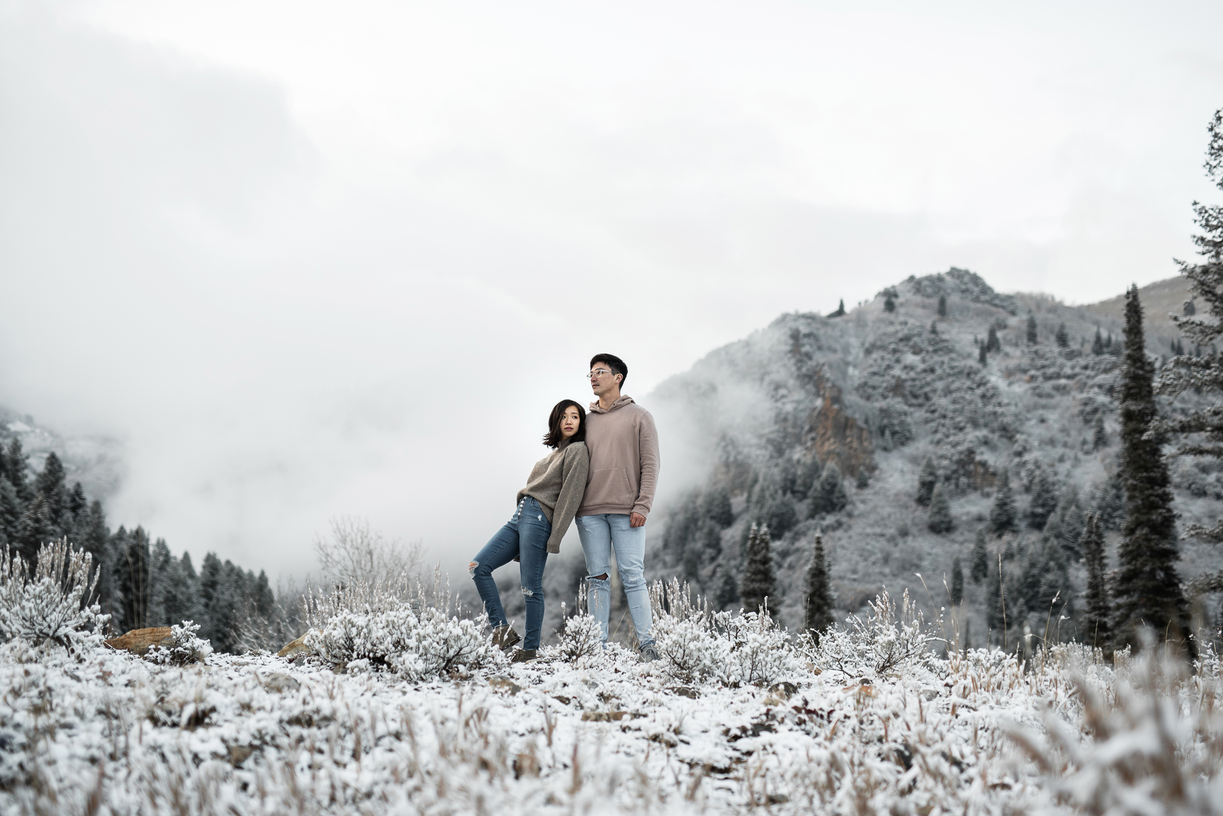 foggy mountainscape with a cute couple