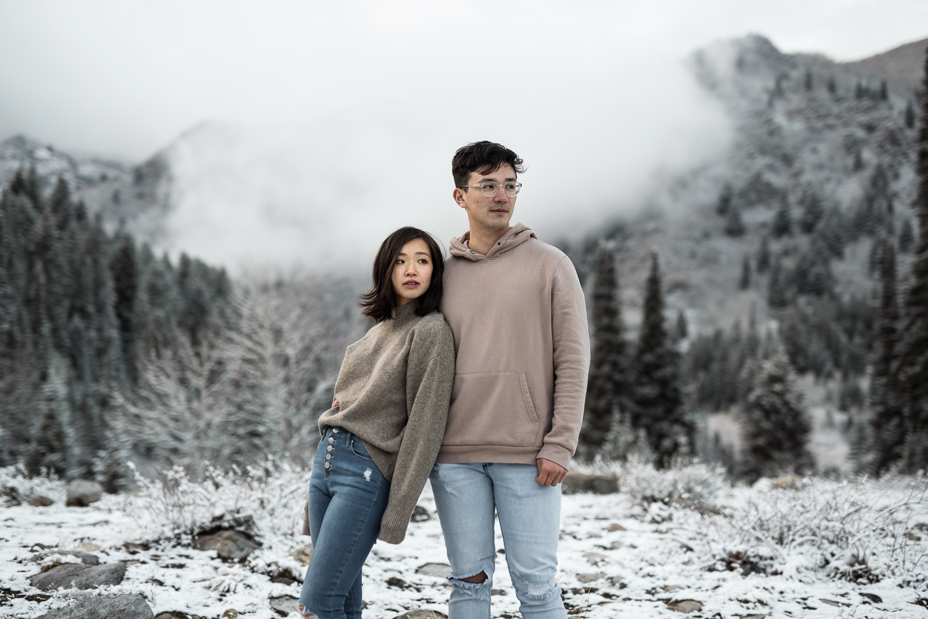 rad couple in front of a snowy mountain