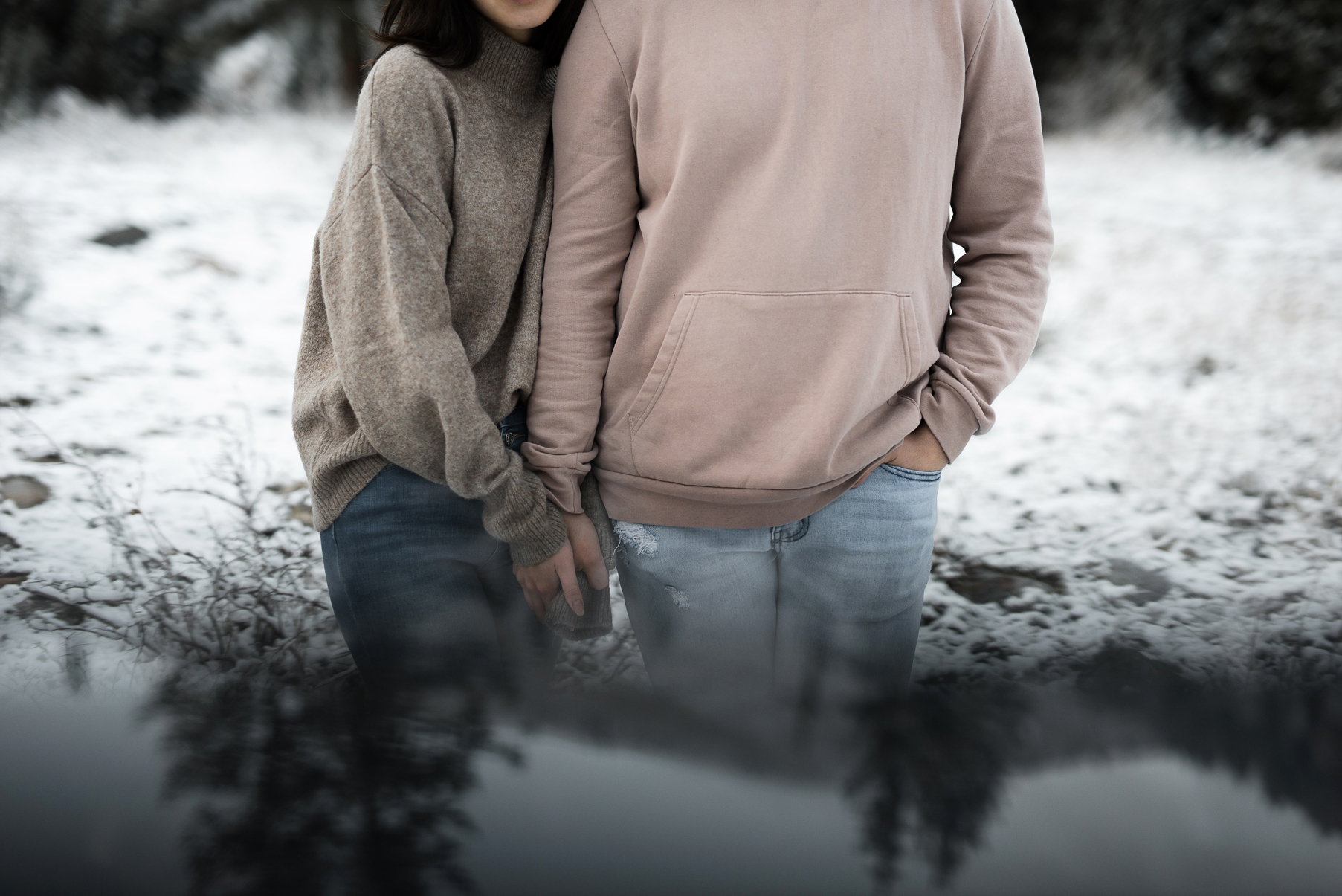 artistic portrait of couple in the snow