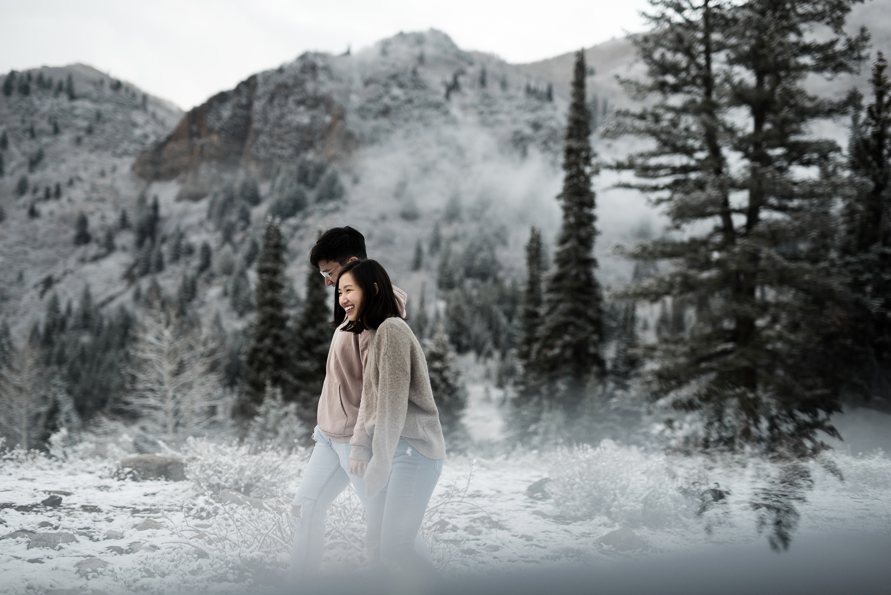 couple walking through utahs mountains