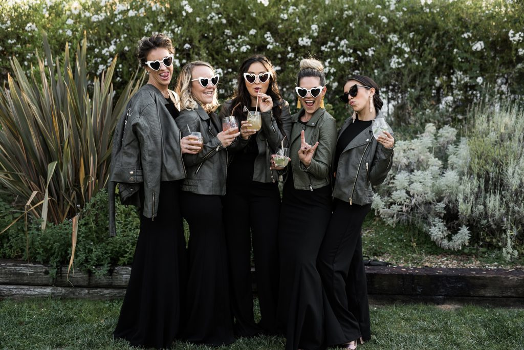 rad bridesmaids with black jumpsuits and leather jackets