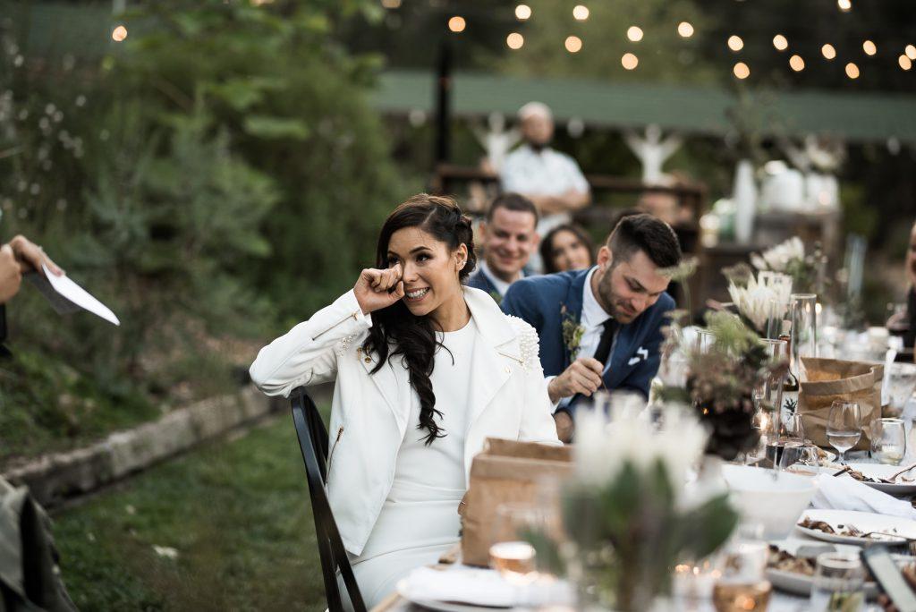 bride tearing up during her bridesmaids speech