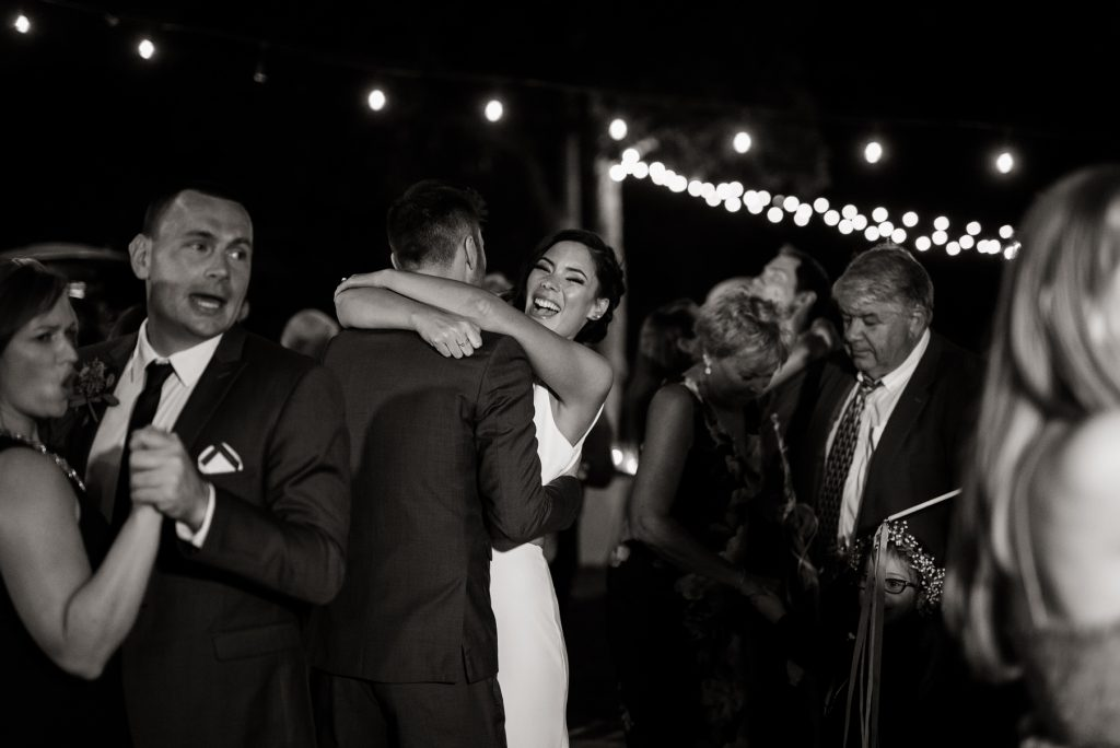 bride and groom dancing with their loved ones
