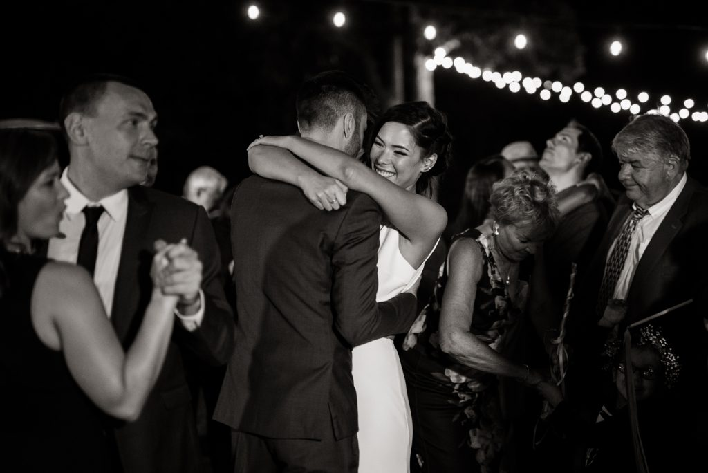 loved ones joining bride and groom for their first dance