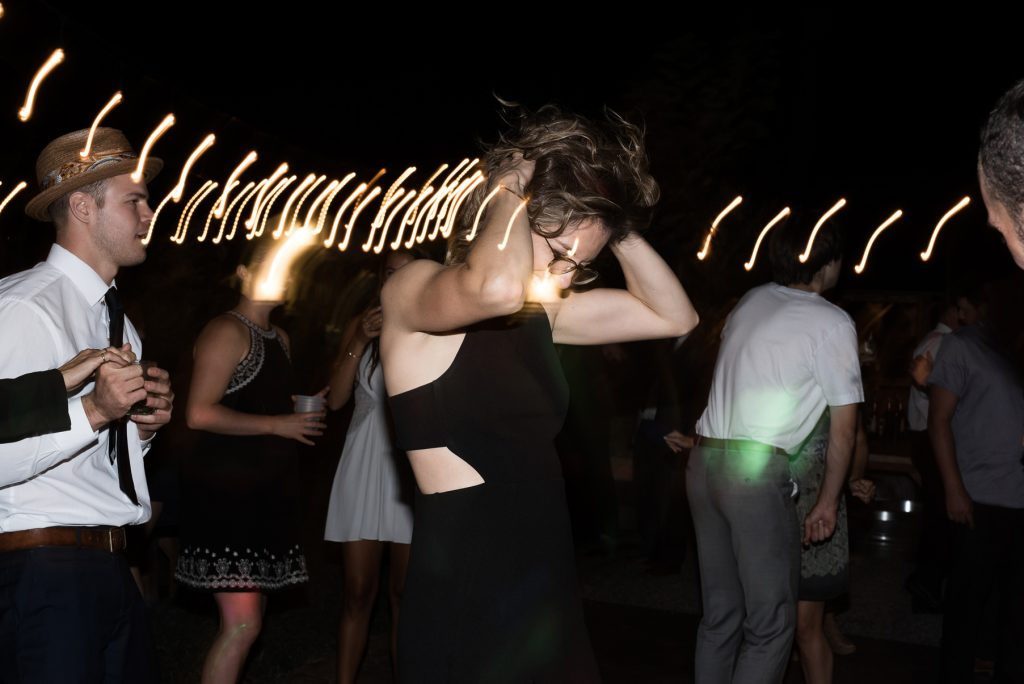 bridesmaid dancing during wedding dinner