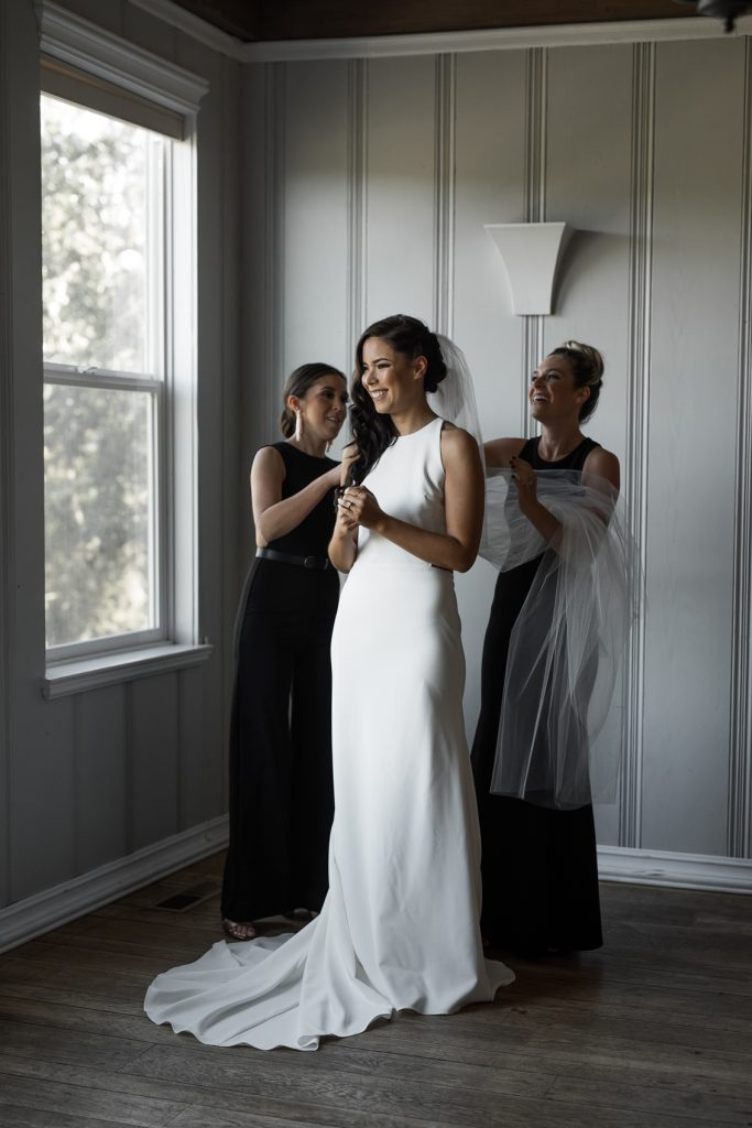 bride getting dressed in her modern sara seven