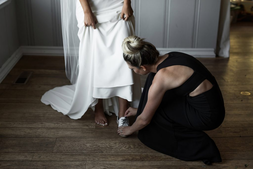 bride putting on her freda salvador loafers