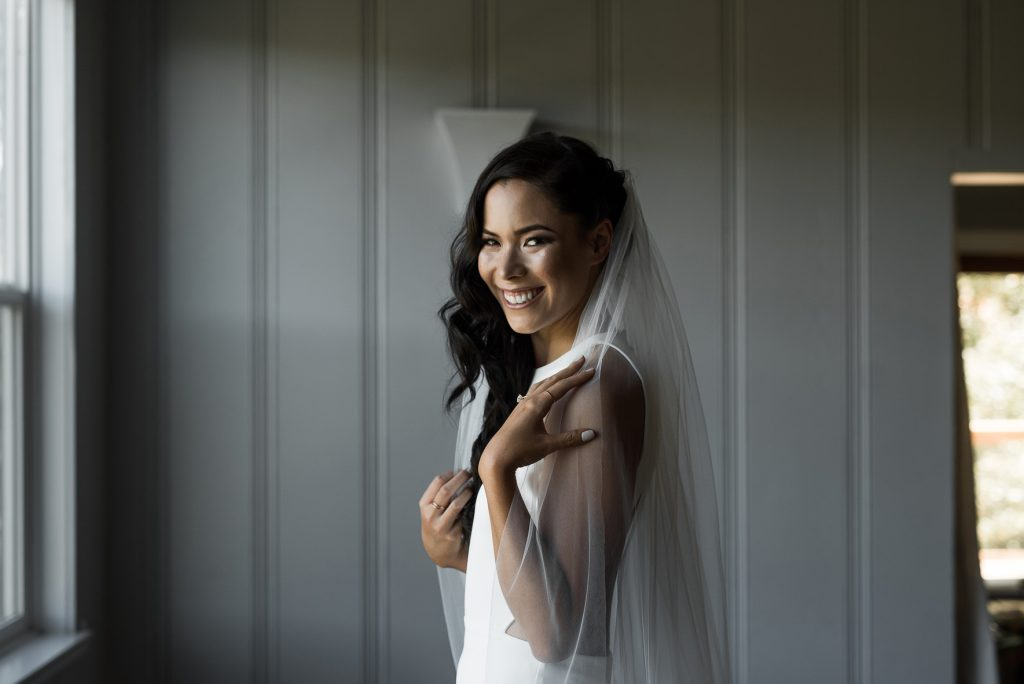 bride getting ready in her modern minimalist wedding gown