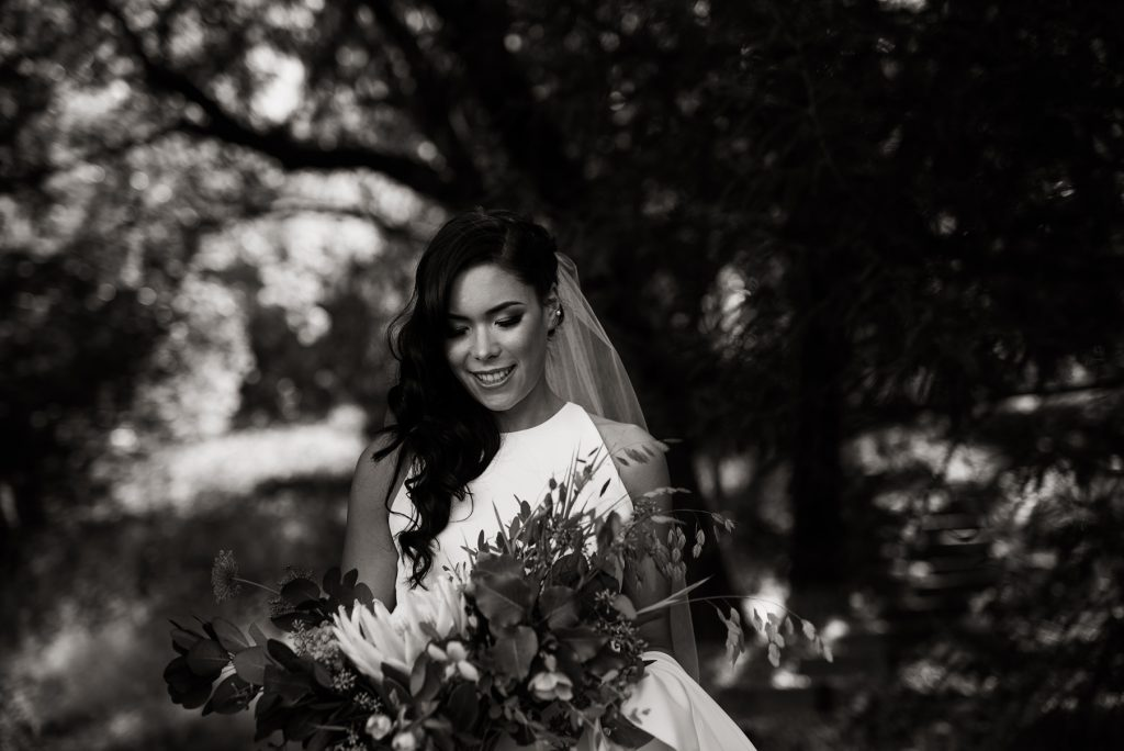 moody black and white portrait of modern bride