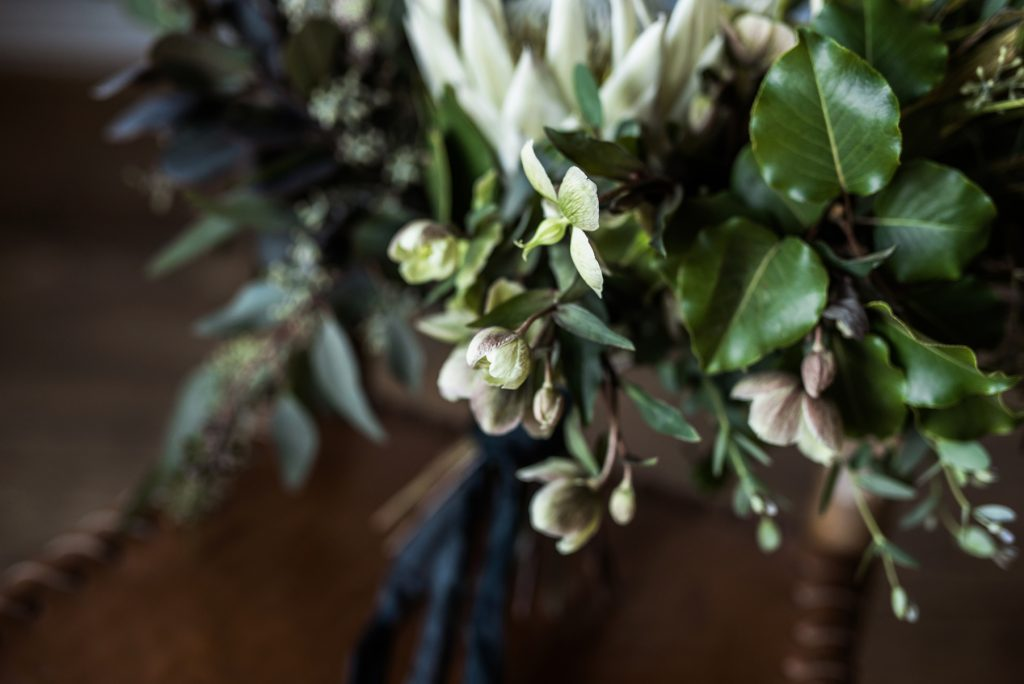 closeup of a greenery bouquet with hellebore flowers