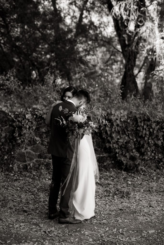 intimate hug between a bride and groom during a first look