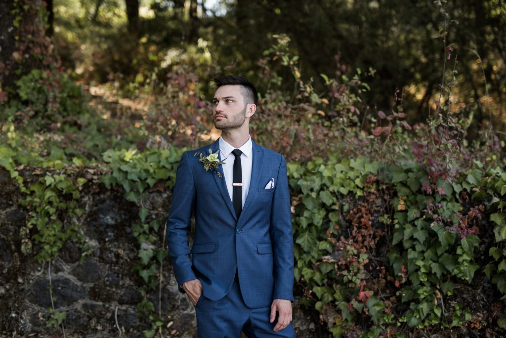 serious portrait of groom before first look