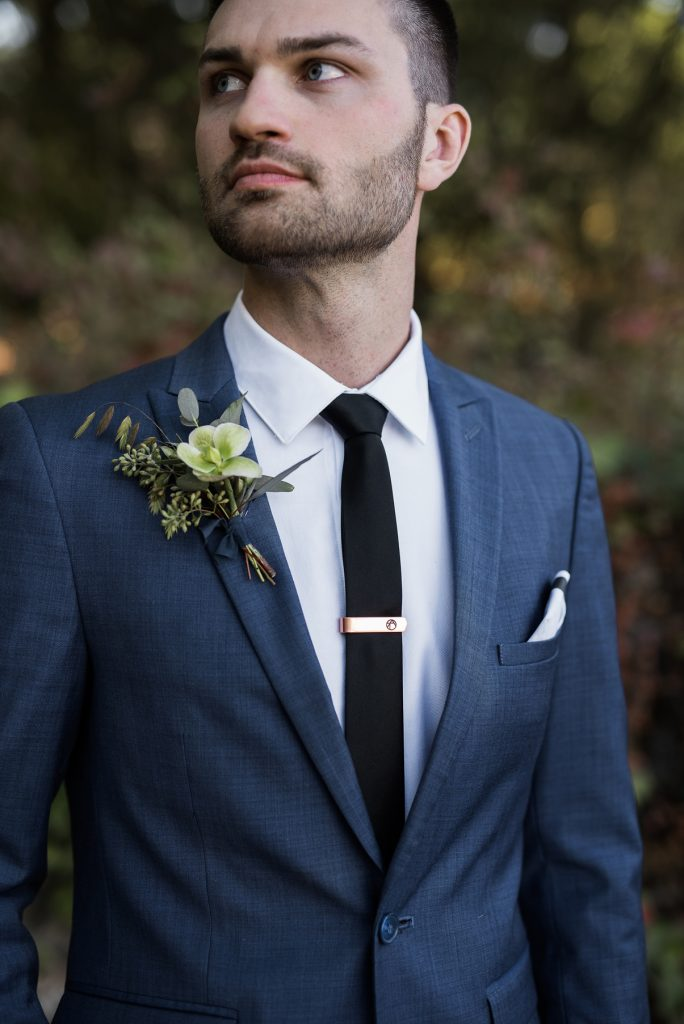 groom wearing a sleek blue suit