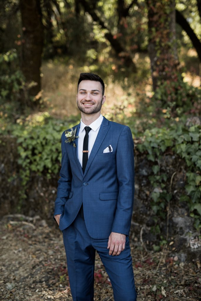 groom wearing a classic blue suit