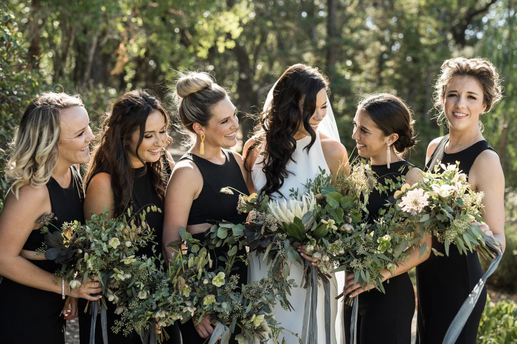 rad bridesmaids in black jumpsuits