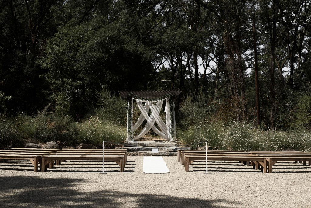 simple ceremony setting with wood benches