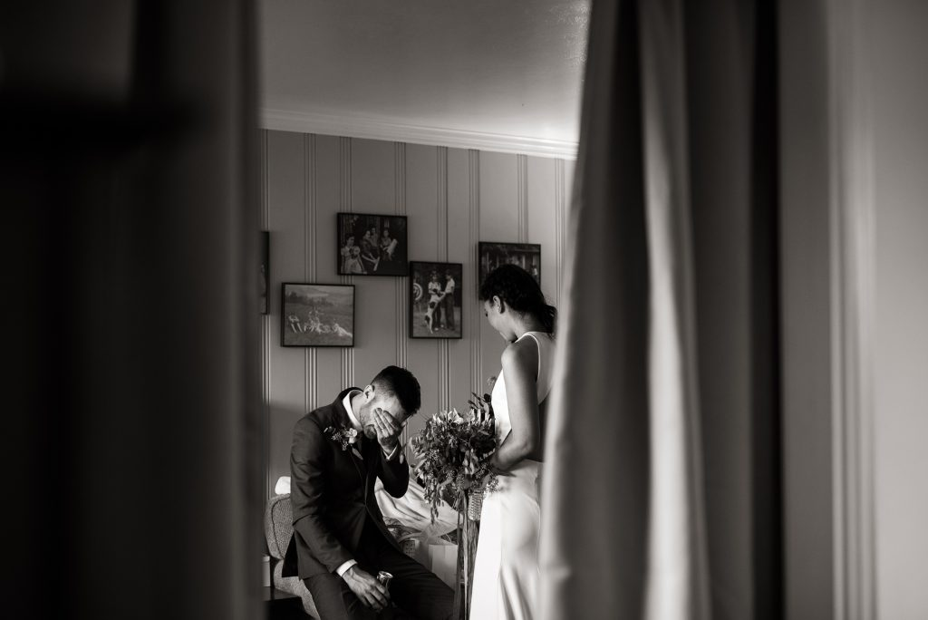 private moment between a bride and groom after their ceremony