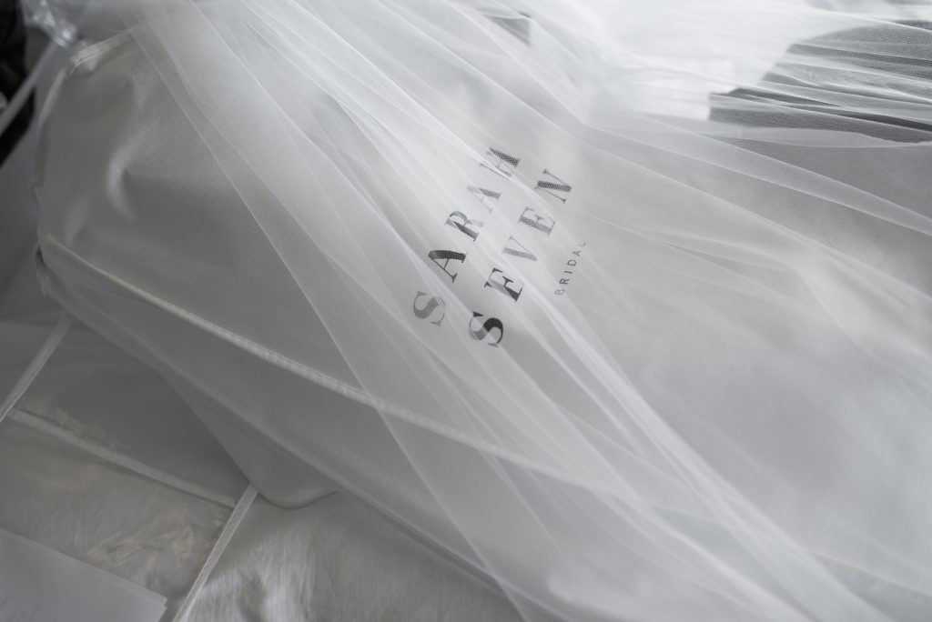 candid detail shot of a sarah seven gown