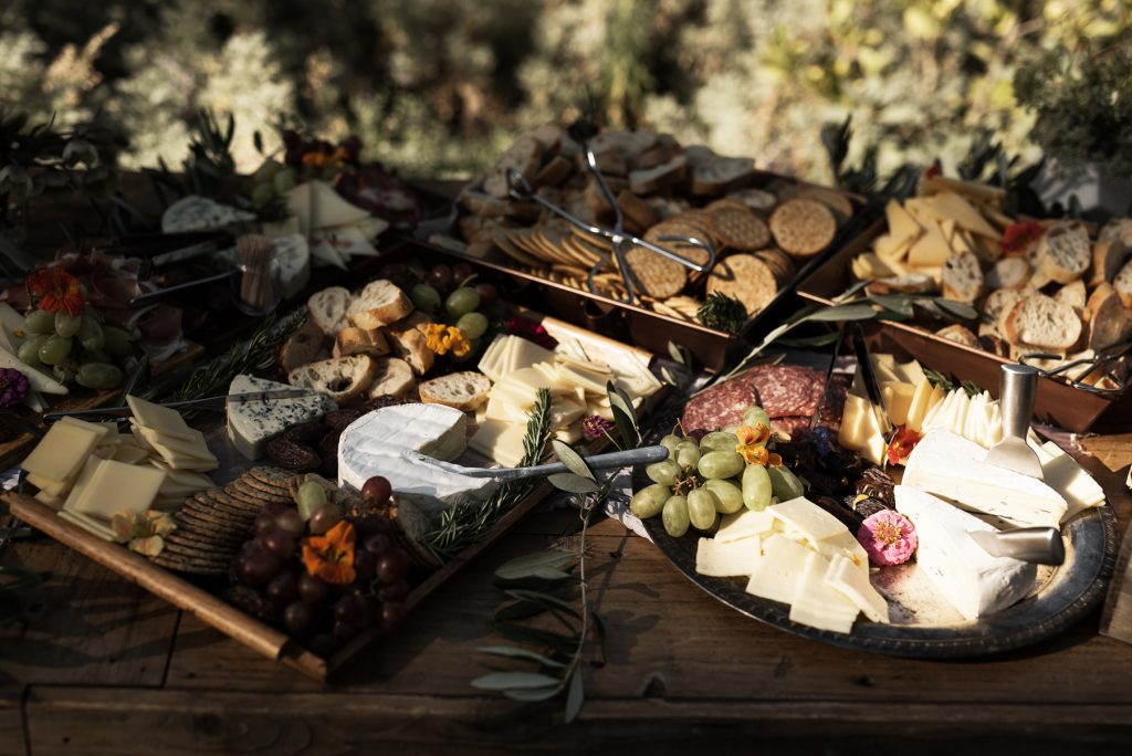 elaborate charcuterie board with edible flowers