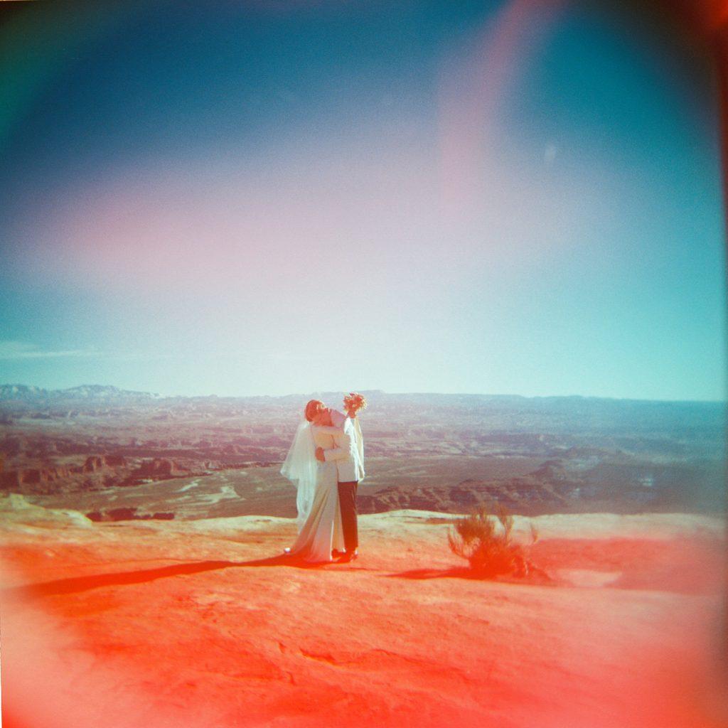 Couple hugging at Canyonlands on holga camera