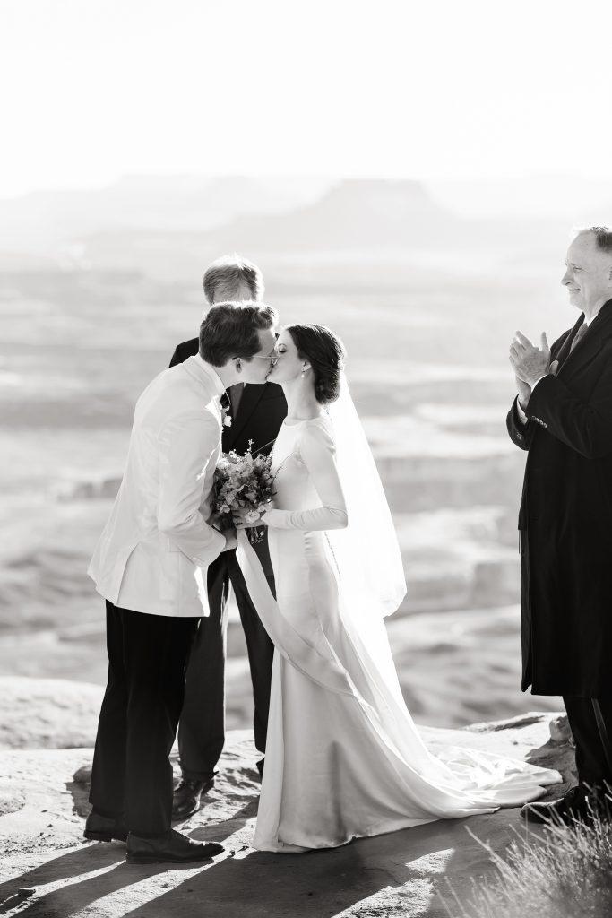 Wedding kiss overlooking Green River Overlook