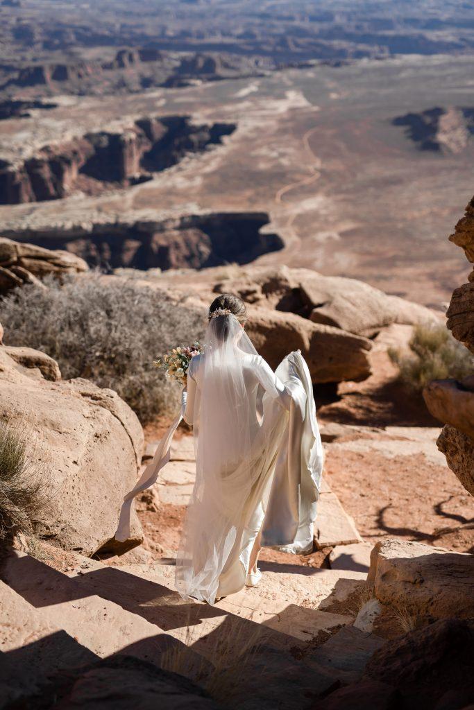 Bride walking to green river overlook