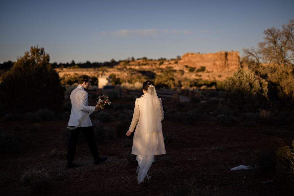 Couple walking canyonlands national park at sunset