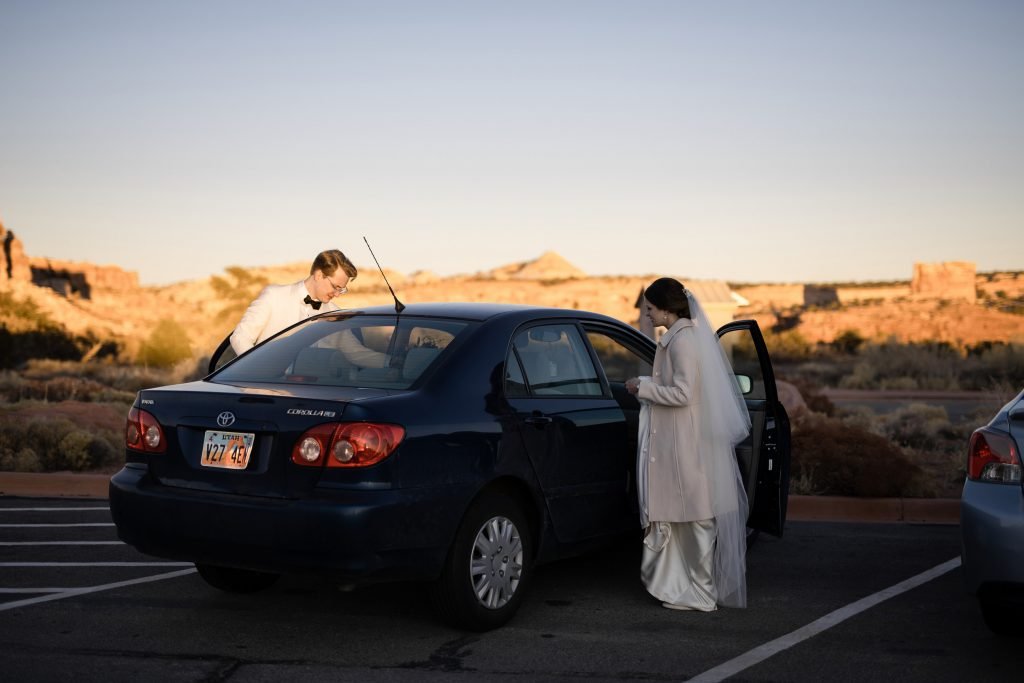 Couple leaving canyonlands national park wedding