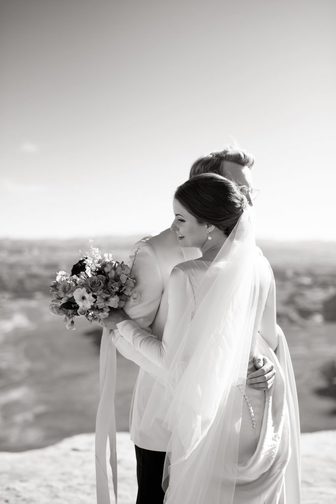 Bride and groom hugging at Green River Overlook