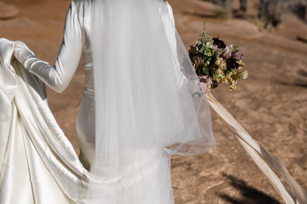 Bride holding dress at Canyonlands