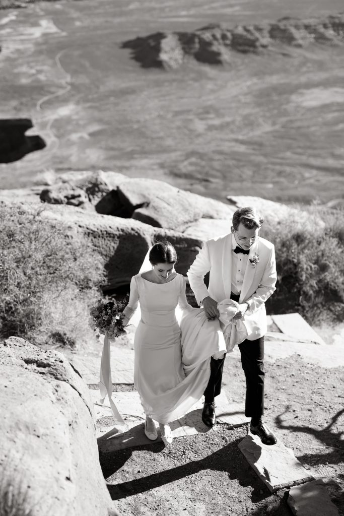 Bride and groom walking green canyon overlook